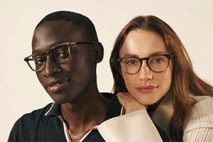Screenshot from Warby Parker of male and female wearing glasses