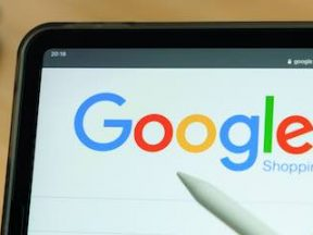 Image of a tablet the Google Shopping logo on the screen