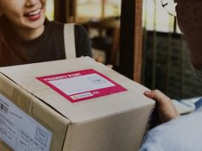Image of a female receiving a package at her front door