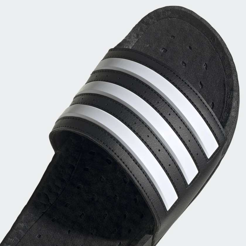 A photo from Adidas.com showing the closeup details of a black sandal