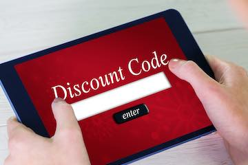 Photo of a tablet with a discount code box on the screen
