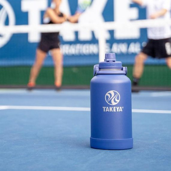 Image of a water blue water bottle on a tennis court out-of-bounds line. Source: TakeyaUSA.com