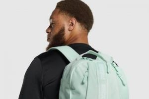 Image from Gymshark of a male wearing a backpack