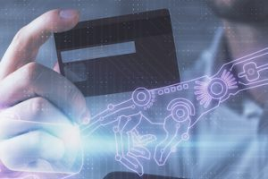 Image of a person holding a credit card