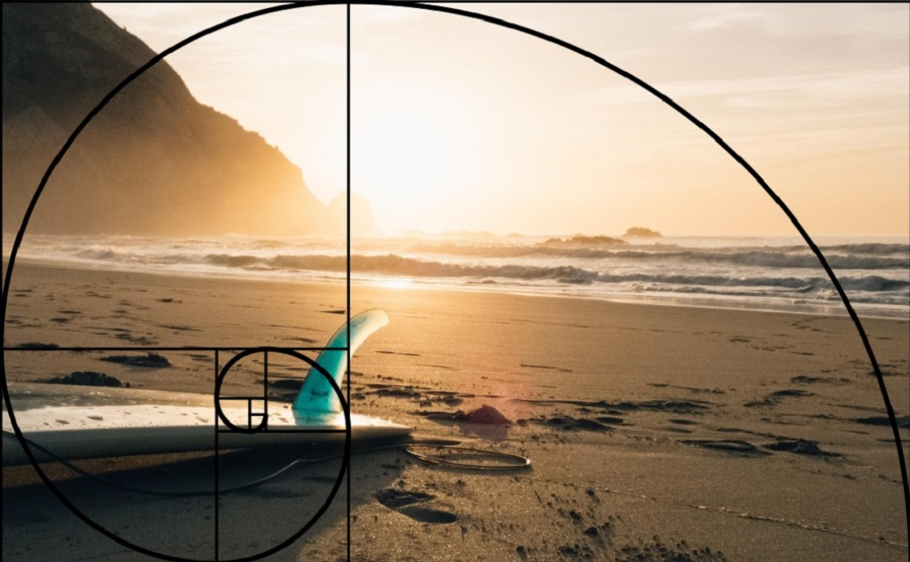 The composition of this image follows the Golden Ratio, with the surfboard at the endpoint of the spiral. Source: Fotowoosh.com.