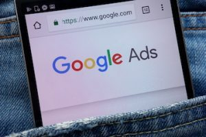 """Photo of smartphone with """"Google Ads"""" logo on the screen"""