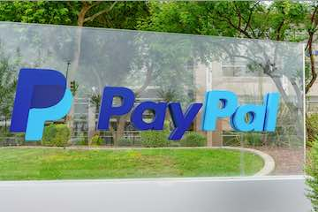 Photo of a PayPal sign in front of an office building