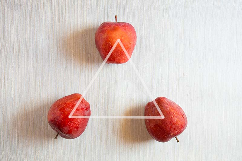 Image from PhotoAxis.com of three apples in a triangle.