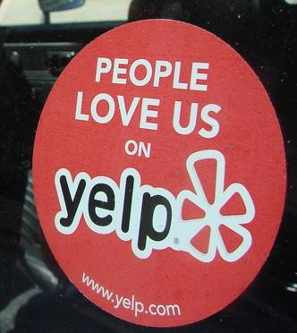 Businesses must qualify to receive the coveted 'People Love Us on Yelp' sticker.